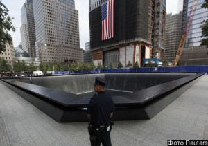 New York police officer stands by the North Pool during ceremonies marking the 10th anniversary of the 9/11 attacks on the World Trade Center in New York